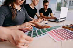 Creative team working together at design studio royalty free stock image