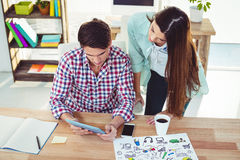 Creative team working together at desk. In casual office Stock Images