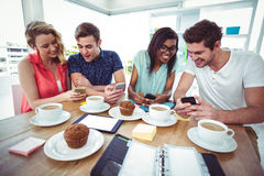 Creative team working together on smartphones Royalty Free Stock Photography