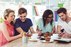 Creative team working together on a tablets and smartphones Stock Image