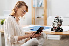 Creative technology specialist testing automatic robot indoors Royalty Free Stock Images