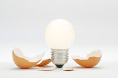 Bright New Innovation Idea Hatching. Creative thinking concept. A light bulb representing a bright new idea which has just hatched and switched on royalty free stock photography
