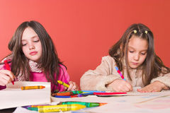 Creative time. Young schoolgirls drawing and writing Royalty Free Stock Image