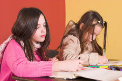 Creative time. Young schoolgirls drawing and coloring Stock Photography