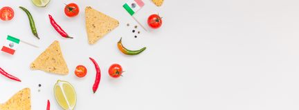 Mexican Food preparation cooking concept. Creative Top view flat lay fresh mexican food ingredients with tortilla nachos chips garlic pepper lime tomatoes on royalty free stock photos
