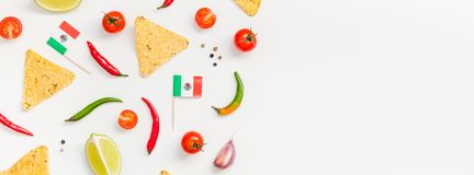 Mexican Food preparation cooking concept. Creative Top view flat lay fresh mexican food ingredients with tortilla nachos chips garlic pepper lime tomatoes on royalty free stock images