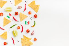Mexican Food preparation cooking concept. Creative Top view flat lay of fresh mexican food ingredients with tortilla nachos chips garlic pepper lime tomatoes on royalty free stock image