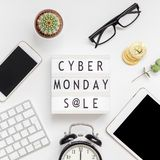 Creative Top view flat lay promotion composition Cyber Monday sale text on lightbox alarm clock white background copy space Square. Template Cyber Monday sale stock image