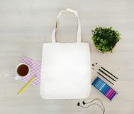 Creative, trendy, artistic eco, tote, cotton bag mock up. Mockup with earphones, a pencil,cup,paints,crayons, tassels. stock image