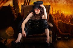 Creative Underground Fashion Photo Illustration. Creative Fine Art Photo Illustration Of An Elegant Fashion Model Sitting In A Rocking Sofa Chair While Ruling Stock Photo