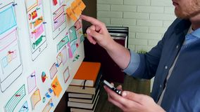 Creative UX designer doing usability research for mobile application stock video footage