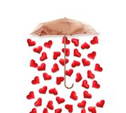 Creative valentines concept photo of umbrella with hearts raining down on white background. Valentines day concept Royalty Free Stock Photos