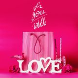 Creative Valentines day concept in bright pink color. For your with love text at shopping bag and decorations . Valentines day stock photos