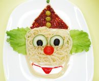 Creative vegetable food dinner clown form Stock Image