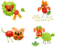 Creative vegetable food snack with tomato Stock Photos