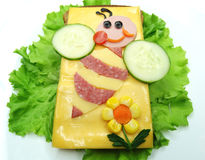 Creative vegetable sandwich with cheese and sausage Stock Images