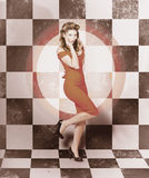 Creative vintage pin-up girl in 50s retro diner Royalty Free Stock Image