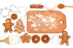 Creative winter time baking background. Kitchen utensils and ingredients for christmas homemade gingerbread cookies on white backg Royalty Free Stock Image