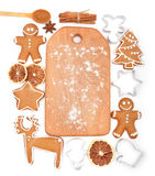 Creative winter time baking background. Kitchen utensils and ingredients for christmas homemade gingerbread cookies on white backg Royalty Free Stock Photos