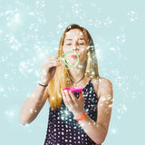 Creative woman blowing birthday party bubbles Stock Photos