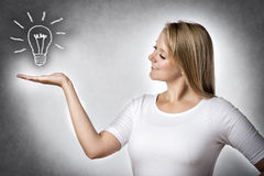Creative woman with bulb Royalty Free Stock Images