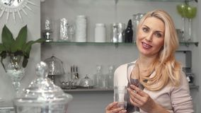 Creative woman chooses glasses for wine royalty free stock images
