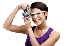 Creative woman hands retro photographic camera. Creative woman in spectacles hands retro photographic camera, isolated on white Royalty Free Stock Photography