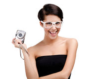 Creative woman holds amateur hand-held camera. Creative woman holds amateur hand-held silver camera, isolated on white stock photography
