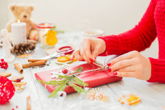 Creative woman making gifts. Creative woman making presents for Christmas celebration stock photos