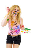Creative woman painting. Everythng with pain on skin and fingerptins on shirt royalty free stock photography