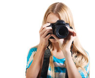 Creative woman photographer takes photos Royalty Free Stock Photos