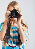 Creative woman photographer takes photos. Creative young woman photographer takes photos stock images
