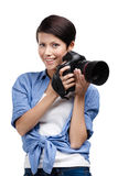 Creative woman-photographer takes snaps Royalty Free Stock Photo