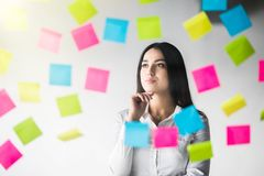 Creative woman Thinking use notes to share idea. Business office. Creative woman Thinking use notes to share idea stock photography