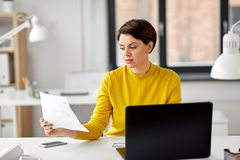 Creative woman working on user interface at office stock photography