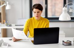 Creative woman working on user interface at office stock image