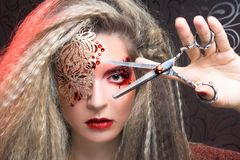Creative woman. Young woman in creative image and with scissors Stock Photography
