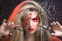 Creative woman. Young woman in creative image and with scissors Royalty Free Stock Photo