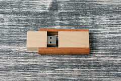 Creative wooden usb stick on dark background Royalty Free Stock Photography