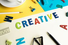 Creative word on desk office background with supplies Royalty Free Stock Photography