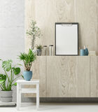 Creative work space, green plants and mock up poster,. 3d illustration Royalty Free Stock Photo