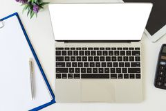 Blank screen laptop mockup on table. royalty free stock image