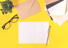 Creative workspace desk on bright yellow background. stock images