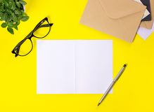 Creative workspace with envelopes on yellow background. royalty free stock photos