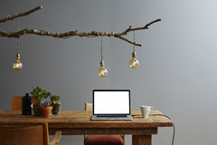 Creative workspace vintage design desk organic lamp design stock image