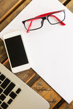 Creative workspace with white paper blank and mobile phone Royalty Free Stock Images
