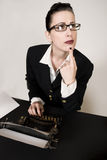 Creative Writer. Retro business woman with vintage typewriter stock image