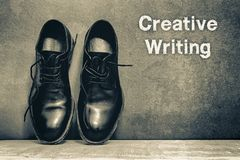 Creative Writing on brown board and work shoes on wooden floor. To mean a concept, innovation, inspiration, artist, background, begin, black, blank, break stock photos