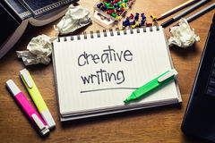 Creative Writing. Handwriting of Creative writing word in notebook on the wood table Stock Photo