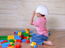 Creative young boy playing with building blocks Stock Photo